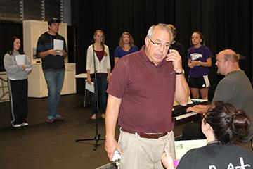 Director Tony Piazza, theater instructor at Allen, gives instruction to cast members during a rehearsal for