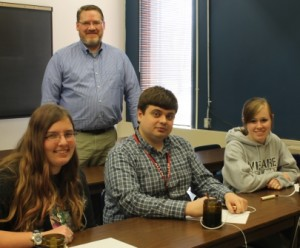 Members of the Allen Academic Excellence Challenge team are, seated from left, Laura Howard, Pavel Kuropatkin, and Arli Hendrix. Standing is Todd Francis, the sponsor. Not pictured are Shayla Stephens and Lorraine Kuzen-Stephens.