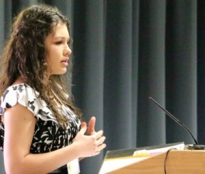 Elvira Avdeyeva gives her speech before a gathering of PTK groups in Kansas. She was elected vice president of the Southern District of state chapters.