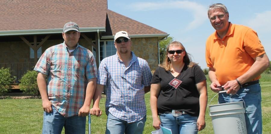 Students who live and work at the Allen farm include, from left, Reid Shipman, Dakota Ferguson, and Danielle Gerdsen. They are with Terry Powelson, right, an agriculture instructor at the college.