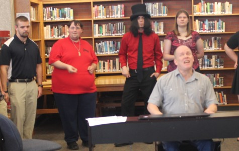 Allen's Devil Frye Vocal Jazz Ensemble backs up local pianist and singer Todd East in a Library Culture Series event on May 7.