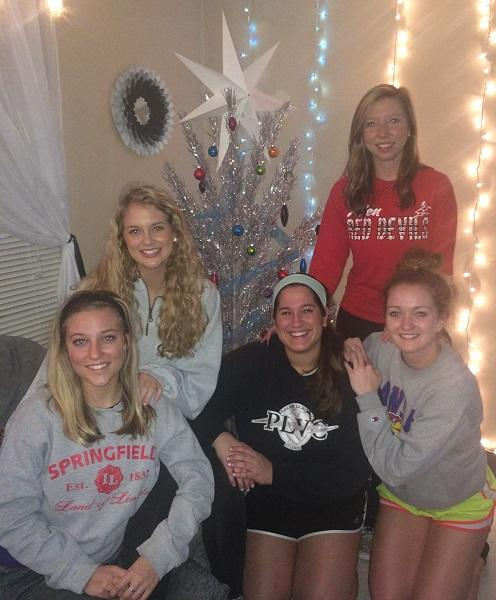 Allen students (left to right) Kayleigh Roberts, Jessica Pollitt, Madi Maguire, Bryanna Svoboda, and Carlyn Jackson decorate their dorm room for the holiday season.