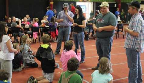 Allen agriculture students Tyler Pedersen, from left, Karl Riffel, Leah Scholz, and Dakota Ferguson speak to are elementary school students during the recent Day at the Farm. The event was held in the activities building due to inclement weather, but about 150 youths from Iola and Humboldt attended.