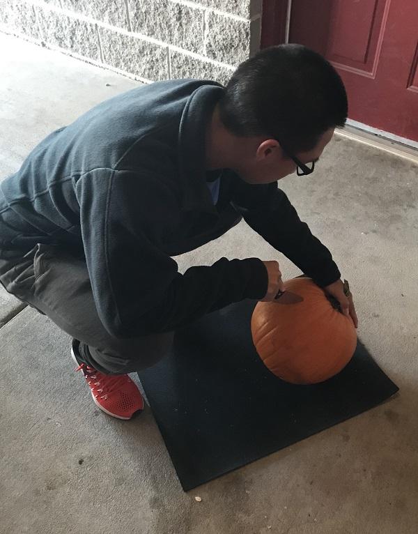 Brandon Phetkhamchanh begins his artwork at the PTK pumpkin carving contest.