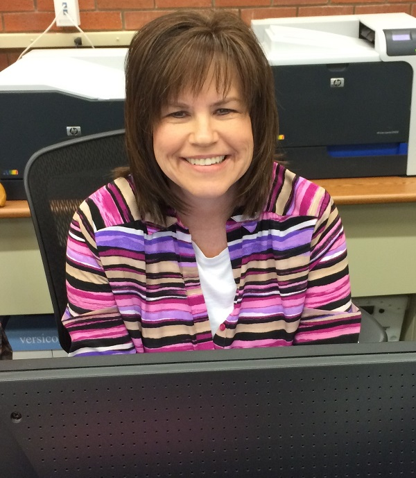 Julie Ingle helps students, faculty and staff in the Allen mailroom.