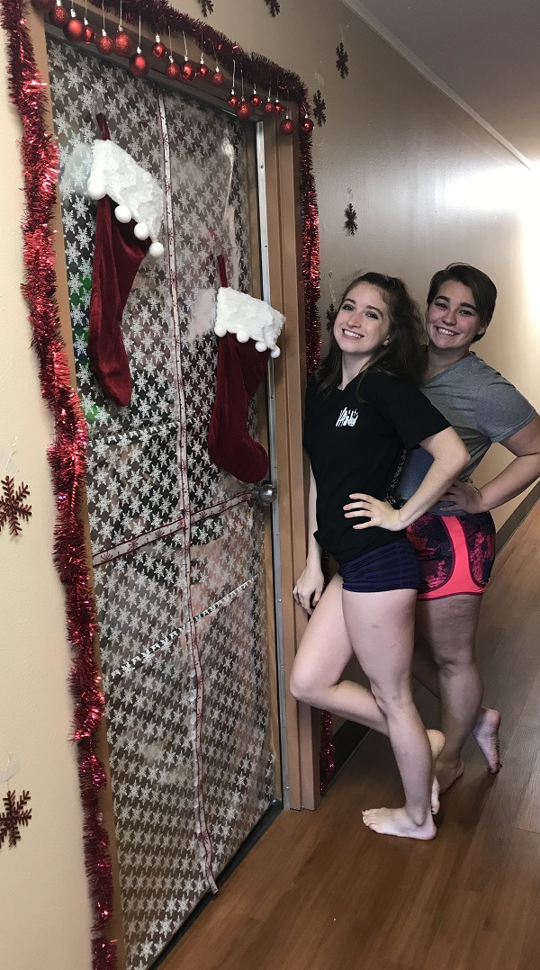 Chelsea King and Mikaela Cofer have elaborated decorated their residence hall door for Christmas.