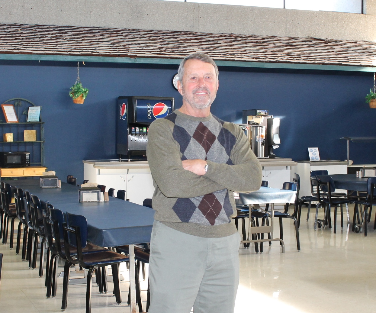 Allen President John Masterson in the college cafeteria, which was originally designed for a fraction of the diners it serves each meal.