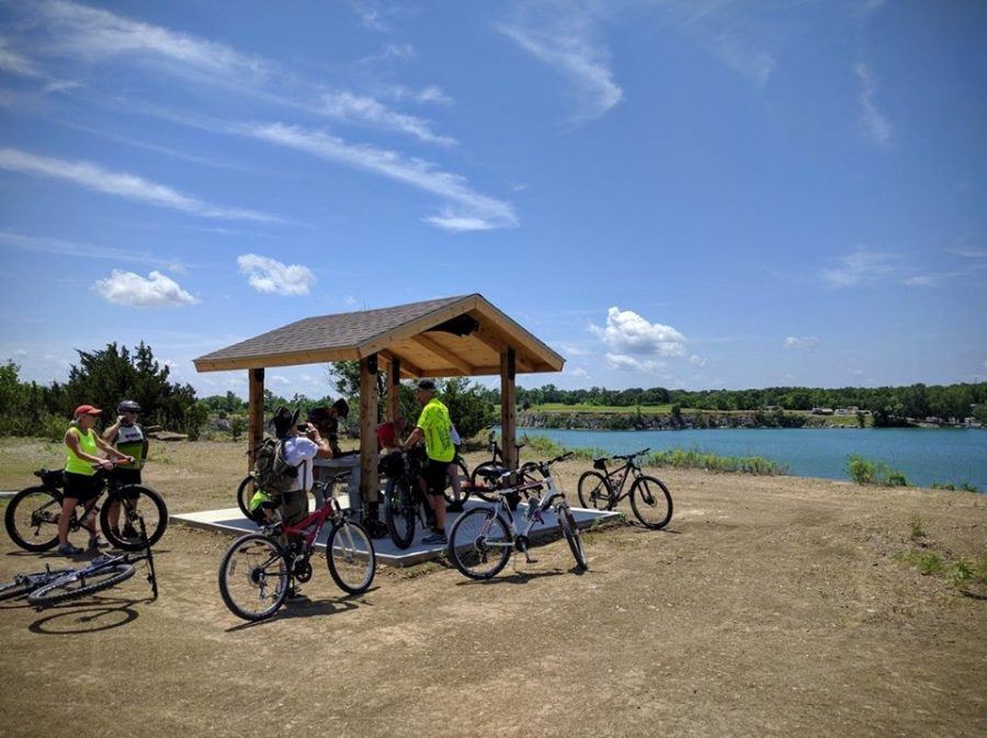 Bikers+enjoy+the+scenery+from+one+of+the+various+rest+areas+on+the+LeHigh+Portland+Trails.+