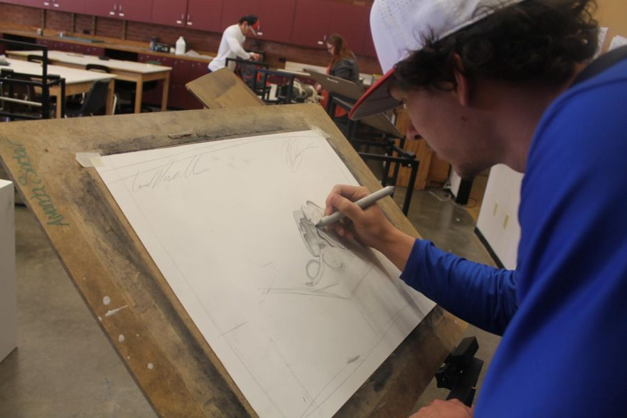 Conner Darnell working on his perspective drawing for his Drawing 2 class.