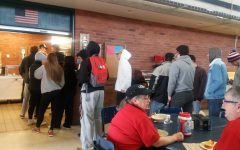 Students wait in line to get lunch from new food service providers, Great Western Dining.