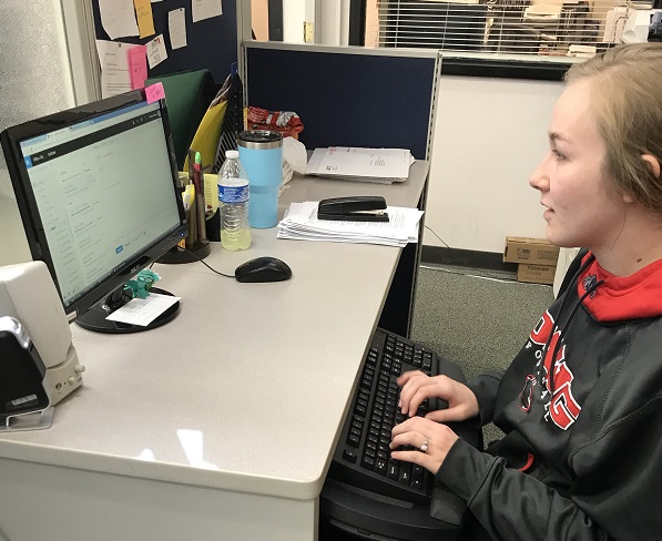 Emily Fritz, a freshman from Garnett, manages her e-mail.