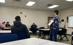 Piazza teaches in front of her public speaking class using the book as an example.