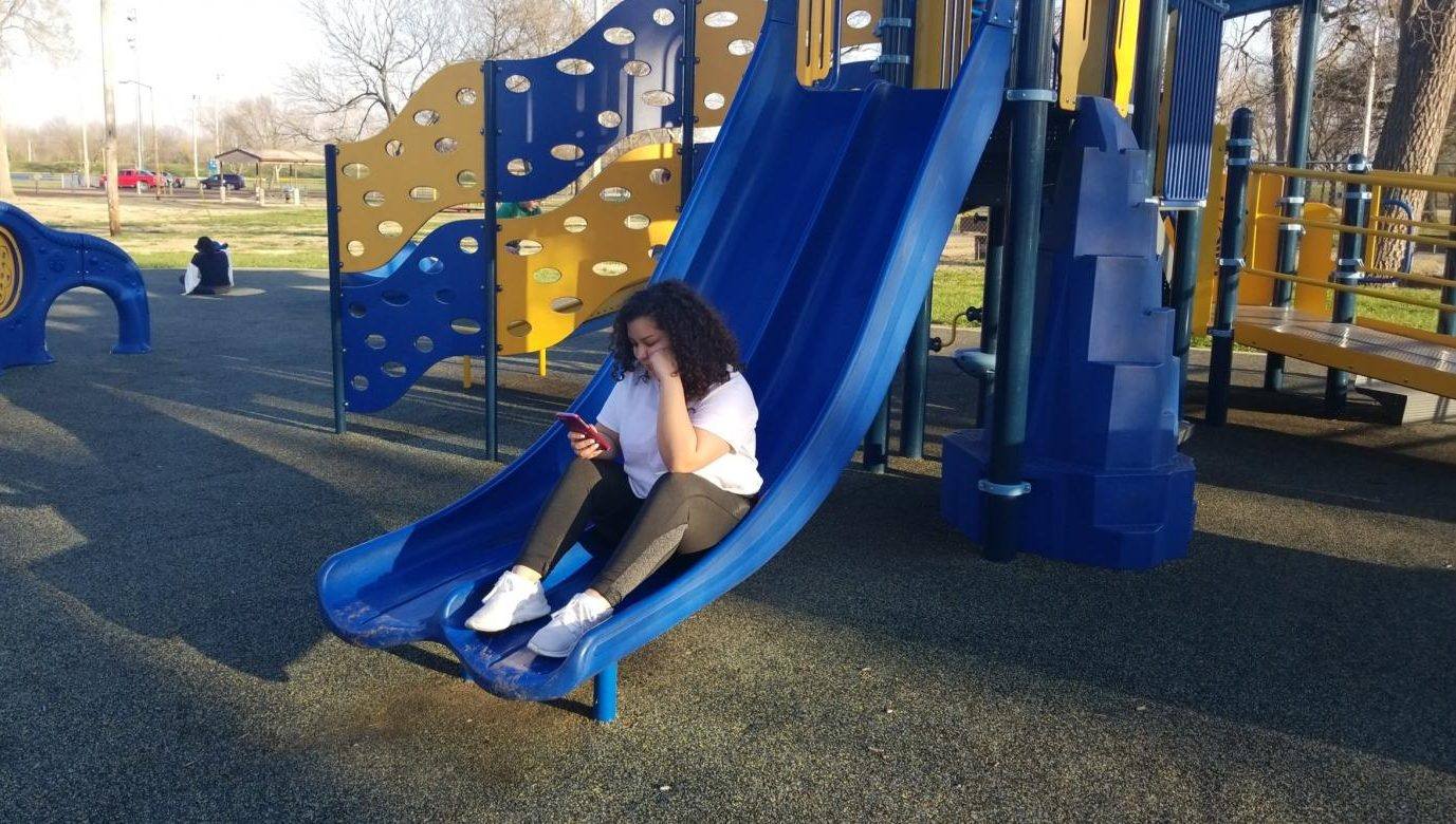 I'M SO BORED... LOL. Allen student Cristal Macias helps illustrate the lack of community appreciation in young people at Riverside Park, in Iola, KS.