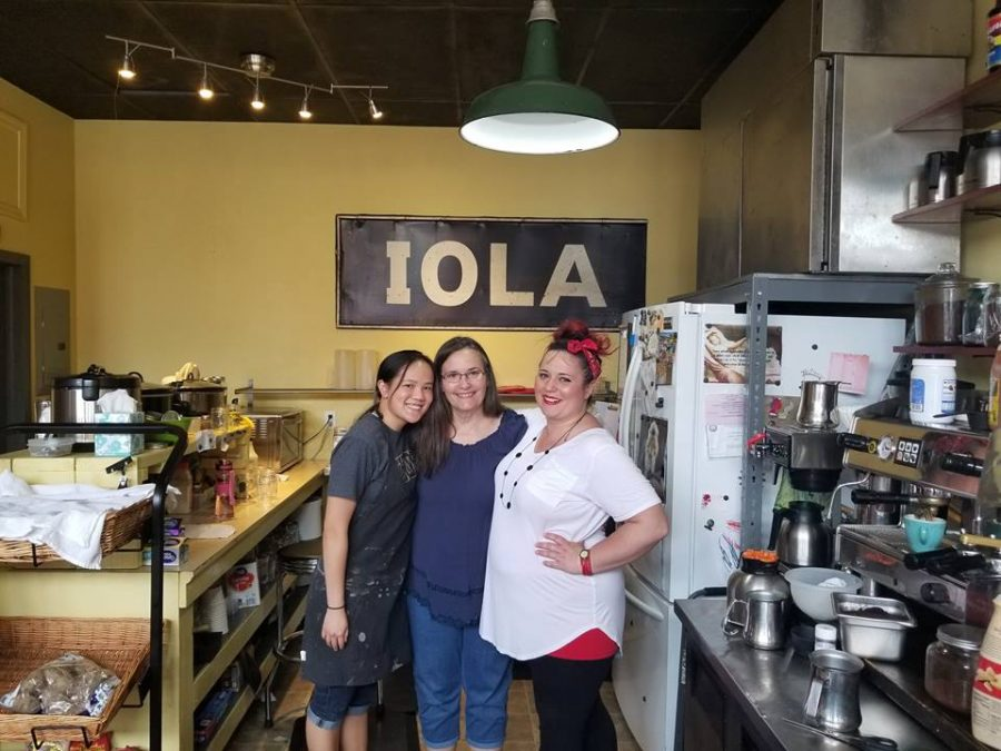 May 2018: Then Sophomore Joie Whitney poses for a photo with Around the Corner owners Cindy Lucas and Jessica Qualls during her afternoon shift at the coffee shop in Iola, KS.
