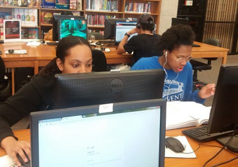 Students use the library computers to access the internet for studies and social media.