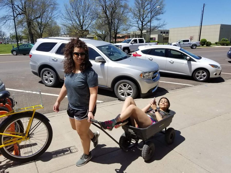 Sophomores Cristal Macias and Adriana Nunez take a break from working on the Pocket Park last Spring.