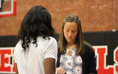 Head Coach Rachel Janzen discusses plays with assistant coach, Cindee Wright.