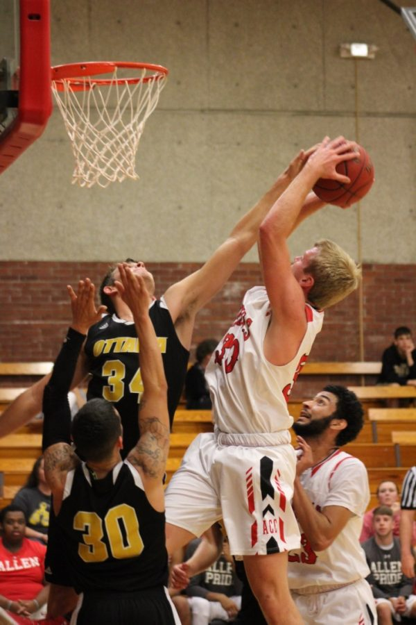 Freshman Brandon Gray goes up for the layup. Although he was close to getting blocked, he made the shot.