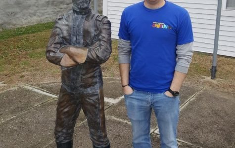 Curator of the Allen County Historical Society Kurtis Russell stands beside the statue of Major General Frederick Funston in downtown Iola, Kan.