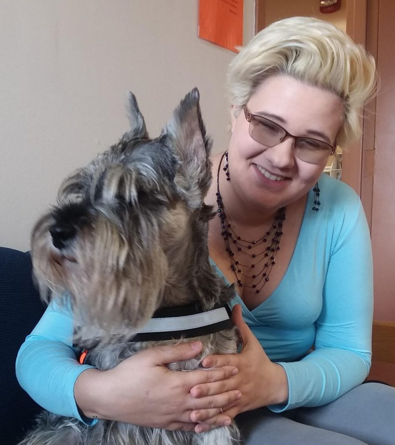 Sierra Wilson with her dog Jade, a Standard Schnauzer service animal.