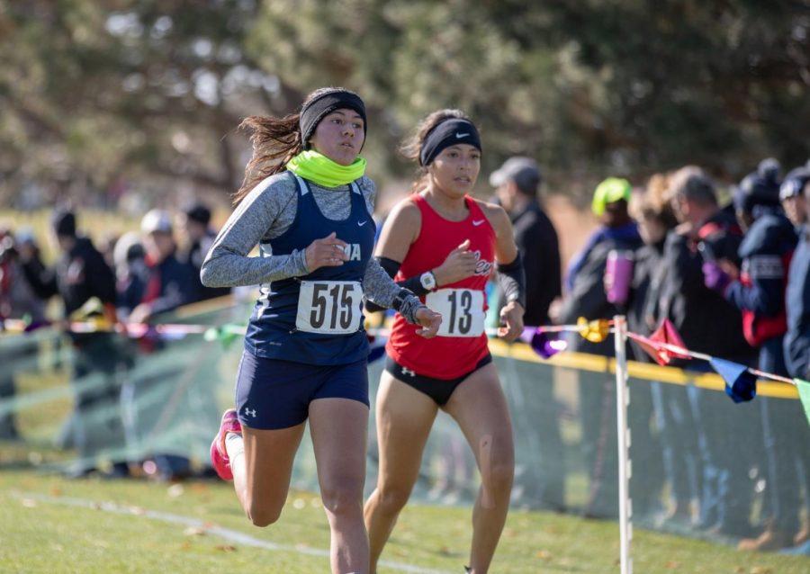 Freshman Emisela Martines runs in temperatures around 50 degrees.