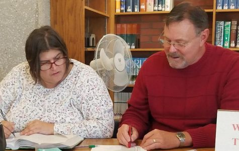 Jerry Vincent, Math Center coordinator for Allen Community College, helps Lisa Burton with an algebra problem in the Academic Support area of the Iola Library.