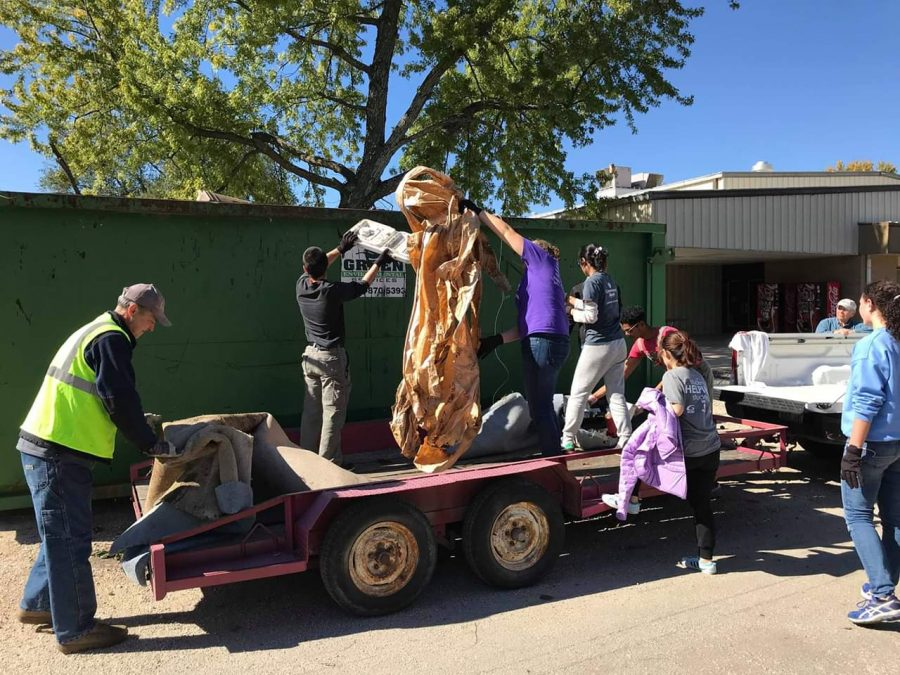 Students and Community volunteers alike played a big role cleaning the yards of 19 La Harpe homes on Oct. 20.