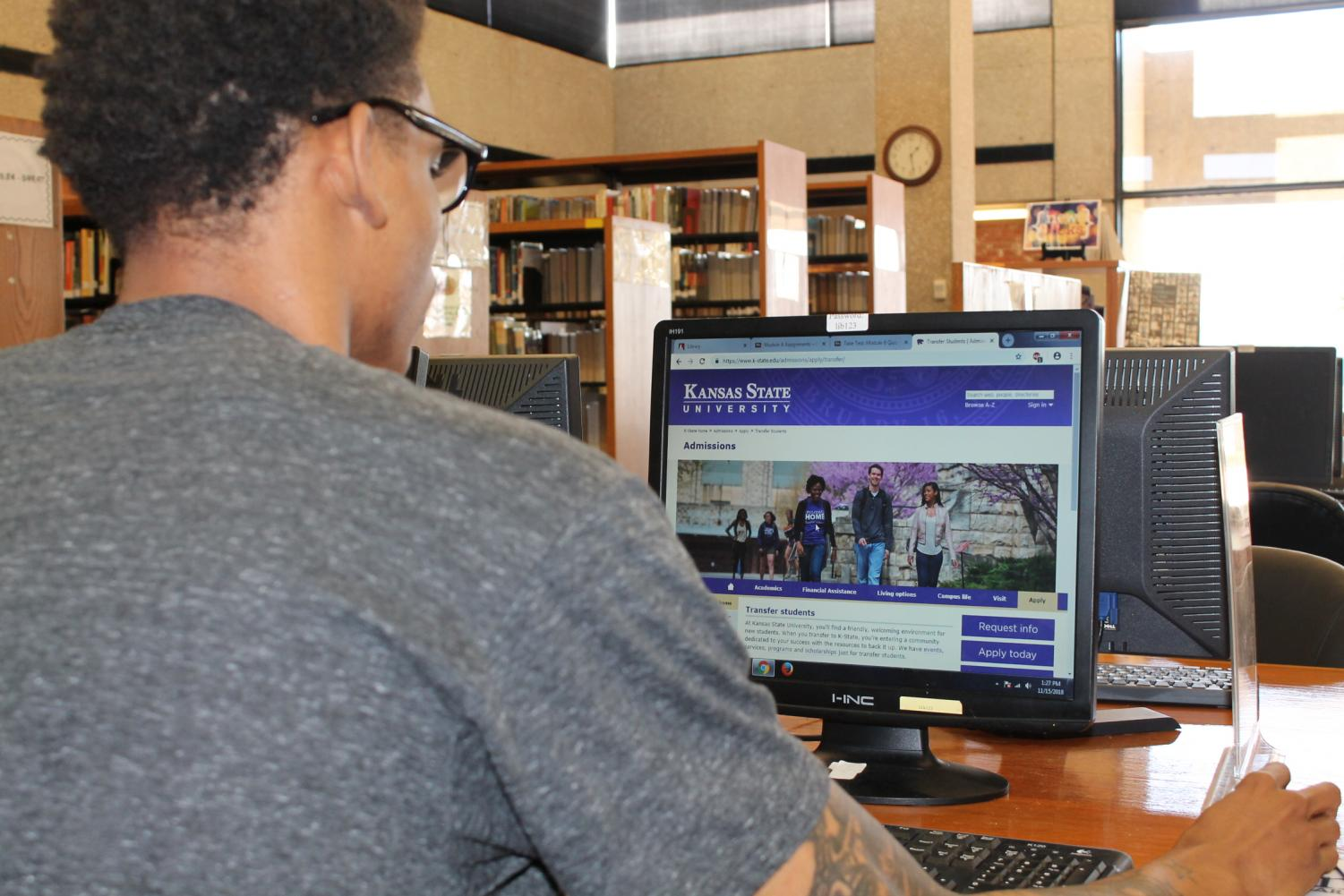 Devonire Glass browses the web for possible transfer schools in the Allen Community College Library.