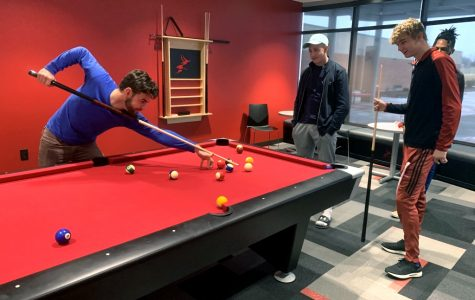 Freshman Justin Carpenter plays pool in the new student center at Allen Community College. The center will officially open Weds. Jan. 23 at 3 p.m.