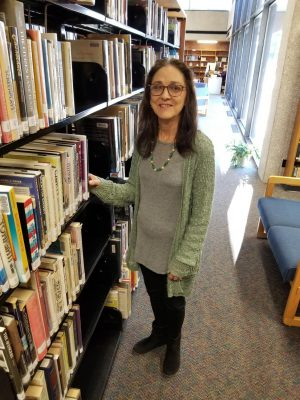 Tosca Harris, Dean of the Iola Campus and Fall 2018 PTK Adviser poses for a photo in the Allen Community College Library.