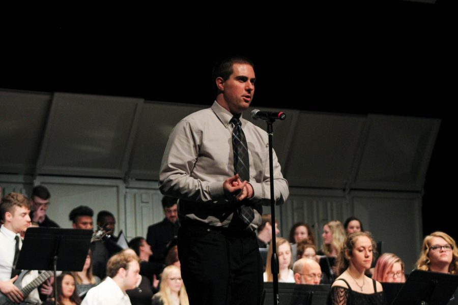 Dr. Jeffrey Anderson, the director of bands at Allen Community College, led the combined choir and bands in their finale performance of