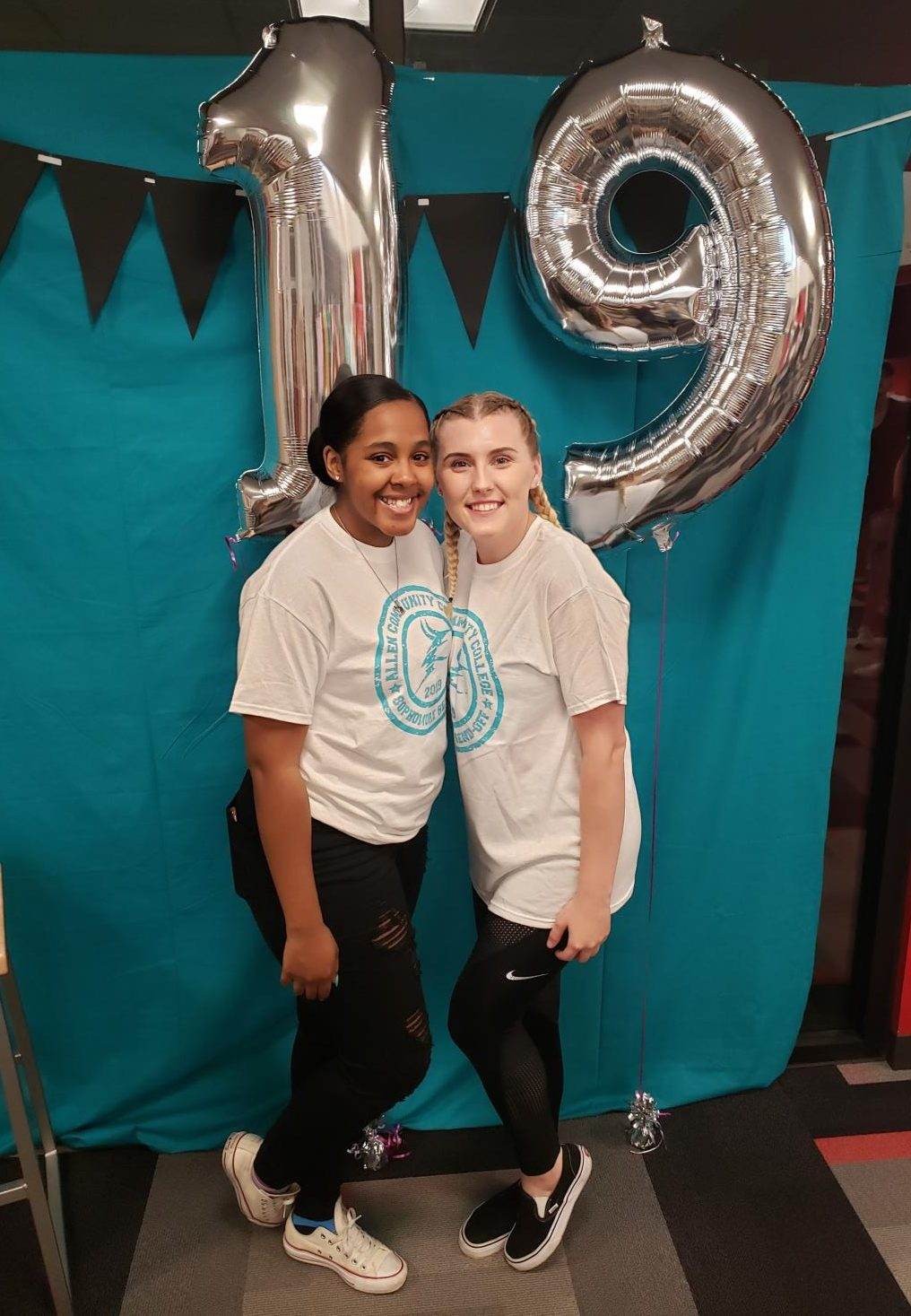 Whitney+Mayberry%2C+who+celebrated+her+19th+birthday+at+the+Sophomore+Send-Off%2C+and+DeAnna+McFadden+posed+for+a+picture+sporting+their+event+shirts%21