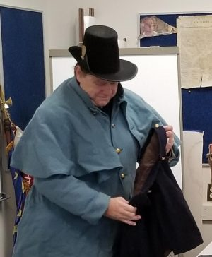 Steve Dodson, history instructor at Allen Community College, shows some weapons, uniforms and other gear he's acquired for Civil War and Revolutionary War re-enactments.