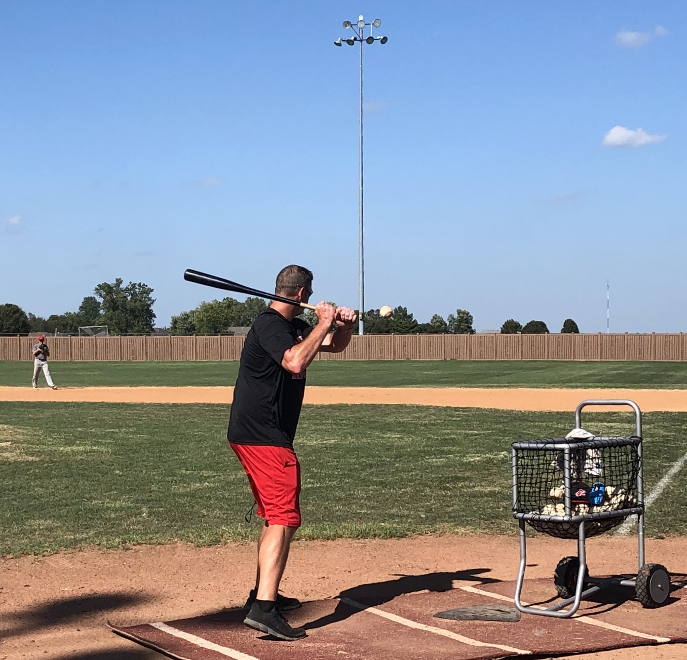 Pitching Coach Drew Noble hits ground balls to infielders.