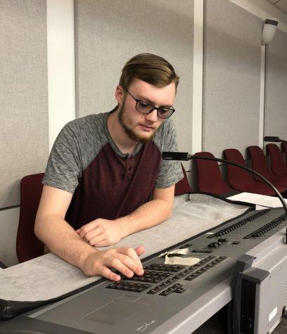 "Crew member Gabriel Rose works the light board for ""Young Frankenstein."""