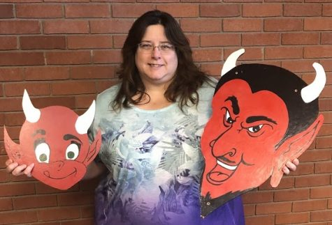 Virginia Shaffer, Allen library director and member of the Centennial Celebration Task Force, displays Allen Red Devil logos from the past which will be incorporated into displays promoting the school