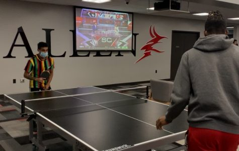 Second-year students Armando Colome and Jelani Heard play ping pong, one of the scheduled Residence Hall Olympic games, in the student center.